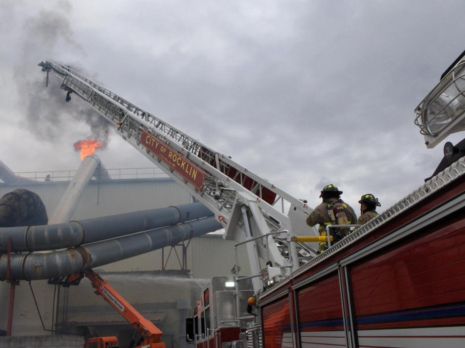 The current ladder truck at a firefighter training.